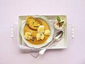 Creamy fish soup with white bread