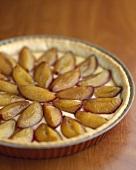 Tarte aux prunes (plum tart, France) in tart tin