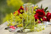 Dill vinegar in jar with roses in background