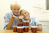 Two blond boys with home-made strawberry jam