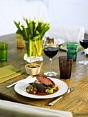Lamb fillet on bean salad with potato and courgette gratin