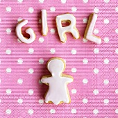 Baked letters spelling 'Girl' and girl figure on napkin