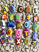 Alphabet painted on pebbles