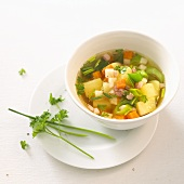 Potato and vegetable soup with diced bacon