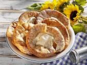 Auszogene (Bavarian doughnuts) on plate with sunflowers