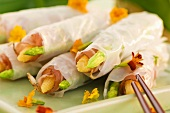 Rice paper rolls filled with bacon, baby corn cobs & asparagus