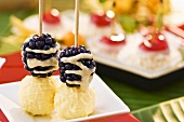 Chocolates & blackberries with chocolate drizzle on cocktail sticks