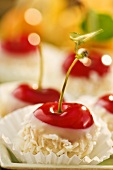 Chocolate-dipped cherries with grated chocolate