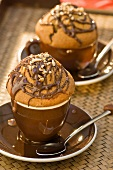 Chocolate muffins in cappuccino cups