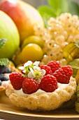 A raspberry tart in a fruit bowl