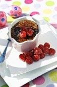 Baked chocolate cream with raspberries