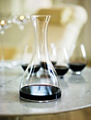Red wine in a carafe and glasses