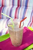 A raspberry smoothie with three straws
