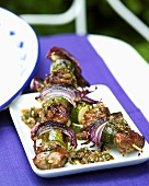 Lamb kebabs with red onions and courgettes