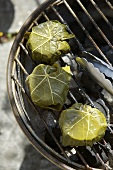 Grilling goat's cheese in vine leaves