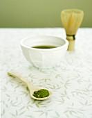 Matcha tea with powdered tea and tea whisk (Japan)