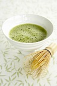 Matcha tea in a tea bowl with tea whisk (Japan)
