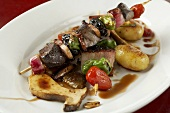 Venison kebab with ceps and roast potatoes