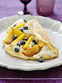 Soufflé omelette with blueberries and peaches