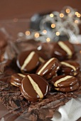 Chocolate-dipped filled biscuits