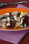 Cheese and grape salad with lamb fillet