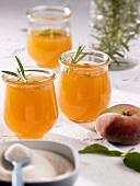 Three jars of peach and rosemary jelly