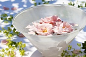 Roses floating in a glass bowl