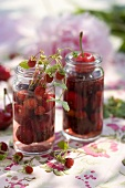 Cherry and wild strawberry liqueur in two jars