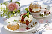 Muffin with cream and strawberry jam