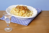 Cheese spaetzle (noodles) with Bergkäse cheese & fried onions