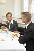 Two people at a business meal