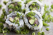 Inside-out sushi with asparagus, tuna and 'negi' (Japanese spring onions)