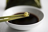 Wasabi on chopstick with soy sauce