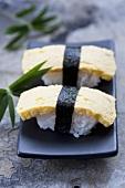Tamago sushi (nigiri sushi with Japanese omlette)