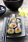 Maki sushi filled with 'sake' and 'kampio' (salmon and squash), Japan