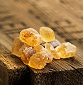 Brown candied sugar on a wooden board