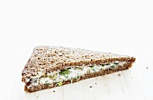 A cream cheese and cress sandwich on wholemeal bread