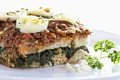 A bread bake with spinach and egg