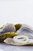 Herrings, onions and gherkins