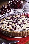 A cherry tart in a glass baking dish