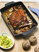 Roast pork with lye pretzel dumplings and potato salad