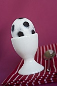 A football egg in an egg cup