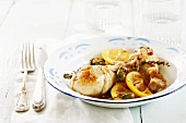 Chicken legs in a lemon and caper sauce