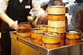 Dim sum in bamboo steamers on a trolley in a Chinese restaurant