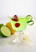 Frozen Margarita with limes and raspberries
