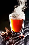 A steaming glass of spiced tea