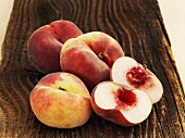 Vineyard peaches on a wooden surface