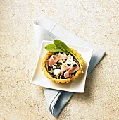 A tartlet with sorrel, Parma ham and goat's cheese