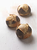 Three poppy seed rolls