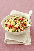 Rice salad with peppers, dried tomatoes, feta and herbs